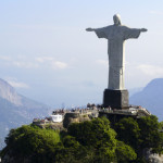 Christ the Redeemer with arms raised over the hill