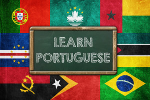 "Flags of Portuguese speaking countries with ""LEARN PORTUGUESE"" written in capital letters on a green blackboard"