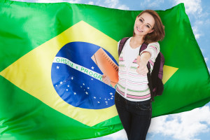Young smiling female student over the Brazilian flag