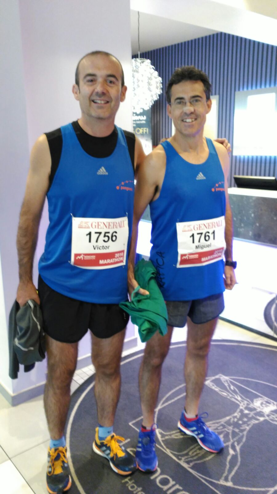 Two members of Pangeanic's running team ready for the race